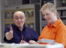 Jacinta Sapwell in high vis clothing with a teacher